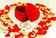Two Rings In Front Of A Red Heart Shaped Box stock photography