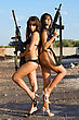 Two Sexy Naked Women Posing With Rifles stock photography
