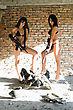 Leggy Two Sexy Women In Underclothes With Rifles And Disarming Soldier stock photo