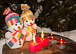 Glowing Two Snowmen With Two Burning Heart Shaped Candles Staying Outdoors stock photo