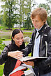 Two Students Studying Outdoors stock photo