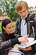 Students Two Students Studying Outdoors stock photo