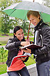 Two Students Under Umbrella In The Park stock photography