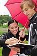 Two Students Under Umbrella In The Park stock photo