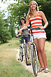 Two Teenage Girls Riding Bikes In The Park stock photo