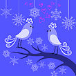 Two Winter Enamored Birds On A Branch Among Snowflakes