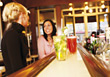 Two Women At Bar Counter Having Drinks stock photo