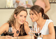 Two Women Talking At Table With Wine Glasses stock image