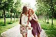 Two Young Happy Girls Having Fun In The Summer Park. Best Friends Laughing And Embracing stock photography