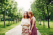 Two Young Pretty Girls Sisters Or Friends Outdoors In Summer Time. Freedom Youth Concept. Happy Young Women. Selective Focus stock photo