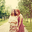 Two Young Pretty Girls Sisters Or Friends Outdoors In Summer Time. Freedom Youth Concept. Happy Young Women. Selective Focus. Image Toned With Warm Colors stock photo
