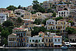 Typical Greece Seaside Town With Many Colorful Houses Built At Hill Over Sea stock image