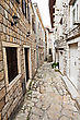 Typical Narrow Cobblestone Street In European City stock photography