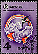 "Emblem USSR - CIRCA 1974: A Postage Stamp Shows A Swallow On A Background Of Clouds And Rainbow And Inscription ""All For A Man For The Sake Of His Future"", EXPO'74, Circa 1974 stock photography"