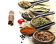 Variety Of Spices In Spoons And Bowls