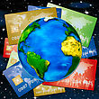 Various Bank Credit Cards On A Globe On A Background Of Night Sky