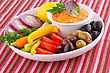 Vegetables, Olives, Lemon And Cheese Sauce On Plate