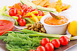 Appetizers Vegetables, Olives, Nachos, Red And Cheese Sause Image stock image