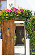 Vintage Entrace Door With Tropical Flowers stock photography