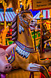 Riding Vintage Merry-go-round Wooden Horses stock photo