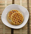 Waffles With Maple Syrup In A White Plate