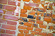 Wall Of Bricks Of Different Shape And Colour