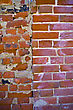 Wall Of Bricks Of Different Shape And Colour stock image