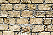 Wall From A Rough Yellow Brick. Background stock photography
