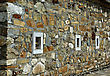 Wall Of An Old Stone Church With Three Small Marble Window stock image