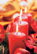 Warmly Lit Red Christmas Candles stock image