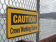 Mesh Warning Signage Hanging From A Wire Fence stock photo