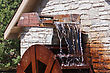 Water Wheel In Motion With Lots Of Rust stock image