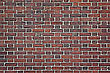 Weathered Stained Old Red Brick Wall Background stock photography