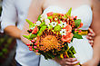 Wedding Bouquet Held By Bride And Groom. Shallow Depth Of Field stock photo