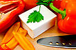 White Brine Cheese, Black Knife, Parsley, Tomatoes And Peppers On A Wooden Board