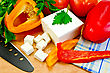 White Brine Cheese, Black Knife, Parsley, Tomatoes, Red And Yellow Bell Pepper, Napkin On A Wooden Board stock image