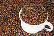 White Cup Full Of Roasted Coffee Beans stock photo