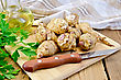 Whole Tubers Of Jerusalem Artichoke With Parsley, Knife, Napkin, Oil On Wooden Board stock photo