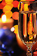 Wineglass With A Champagne On A Background Of Multicoloured Sparks stock image