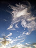 Fluffy Wispy Clouds In The Sky stock photo