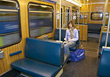 Commuting Woman Alone On Subway Train stock photography