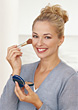 Woman Applying Powder Make-up stock photo