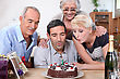 Woman Blowing Birthday Candles In Family stock image