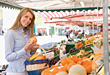 Woman Buying Fresh Fruits and Vegetables stock photo