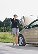 Woman With Car Trouble Taking On Cell Phone stock photo