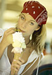 Women Portraits Woman Eating A Big Ice Cream Cone stock photo