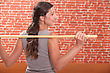 Woman Exercising With A Stick stock photo