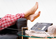 Woman with Feet Up Chatting on Phone stock photo