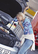 Car Mechanics Woman Having Car Troubles stock photo