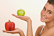 Woman Holding Apple and Pepper stock photography